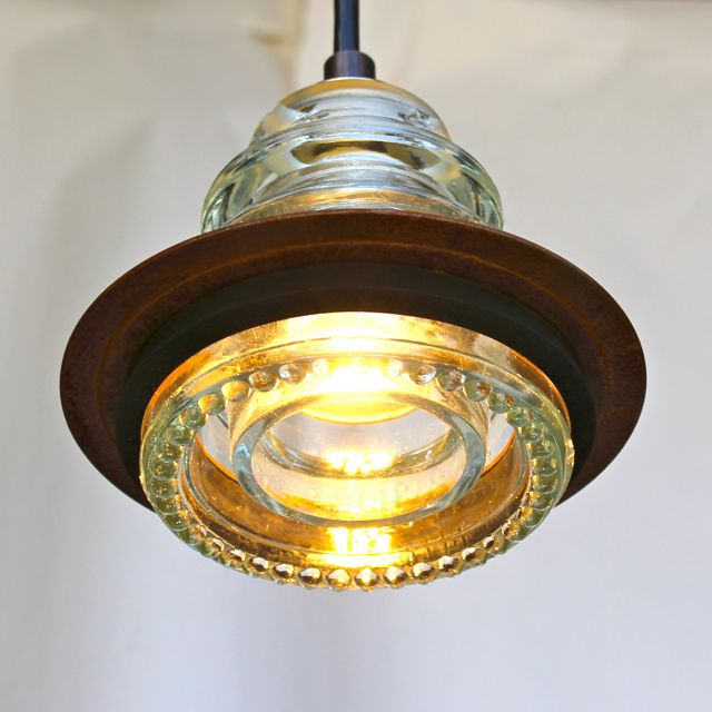 Insulator light metal ring pendant